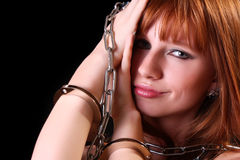 Young hot woman with handcuffs and chain Royalty Free Stock Photo