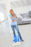 Young house keeper cleaning house. Young housekeeper cleaning floor in senior home royalty free stock photos