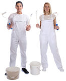 Young house painters decorators apprentice trainees paint bucket Stock Photos