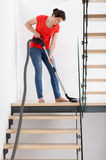 Young housekeeper during hoovering Royalty Free Stock Images