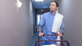 Young housekeeping worker offering cleaning services for hotel guests stock footage