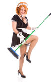 Young housemaid with broom Stock Photography