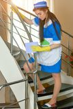 Young housemaid with rag working. Royalty Free Stock Photography