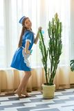 Young housemaid smiling. Royalty Free Stock Photo