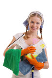 Young housewife. In rubber gloves on a white background royalty free stock images