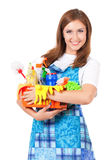 Young housewife. With cleaning supplies, isolated on white background Royalty Free Stock Photo