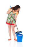 Young housewife. With blue bucket and mop, isolated on white background Royalty Free Stock Images