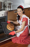 Young housewife baking bread Stock Images