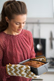 Young housewife with baking dish with bread Stock Image
