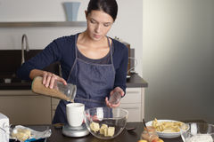 Young housewife baking in the kitchen Royalty Free Stock Image
