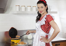 Young housewife baking waffles Stock Photo