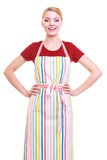 Young housewife or barista wearing kitchen apron isolated Stock Images