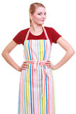 Young housewife or barista wearing kitchen apron isolated Stock Photography