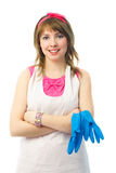 Young housewife with blue rubber gloves. Portrait of a beautiful satisfied young housewife with blue rubber gloves royalty free stock photos