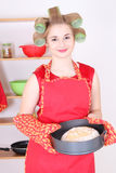 Young housewife with bread in the kitchen Royalty Free Stock Image