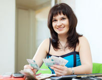 Young housewife calculates budget stock photos