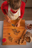 Young housewife chopping walnuts Royalty Free Stock Photo
