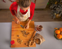 Young housewife chopping walnuts Stock Photos