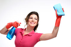 Young housewife cleaning. On white Royalty Free Stock Photography
