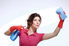 Young housewife cleaning. On white stock photo