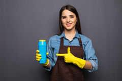 Young housewife cleaning with detergents in hands on grey backgroung Stock Photo