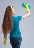 Young housewife cleaning. Rear view Royalty Free Stock Images