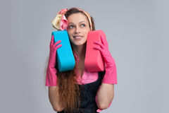 Young housewife with cleaning sponge Royalty Free Stock Images