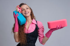Young housewife with cleaning sponge Royalty Free Stock Photo