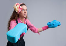 Young housewife with cleaning sponge Royalty Free Stock Image