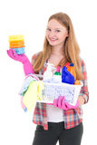 Young housewife with cleaning supplies isolated on white backgro Stock Photo