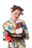Young housewife with cookies in frying pan Stock Photography