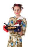 Young housewife with cookies in frying pan Royalty Free Stock Images