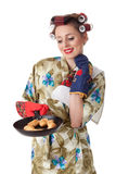 Young housewife with cookies in frying pan Royalty Free Stock Photo