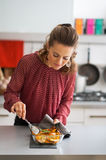 Young housewife cooking baked pumpkin Stock Photos
