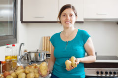 Young housewife cooking potatoes Royalty Free Stock Photography