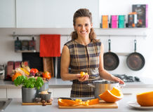 Young housewife cooking pumpkin Stock Image