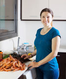 Young housewife cooking seafood Royalty Free Stock Photography