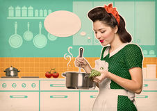 Young housewife cooks in the kitchen with speech bubble Stock Photography