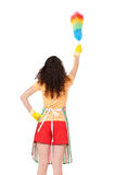 Young housewife with duster Royalty Free Stock Photos