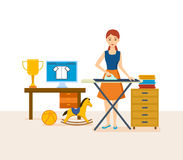 Young housewife engaged in household chores, cleaned, strokes things. Royalty Free Stock Photos