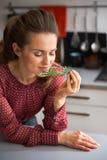 Young housewife enjoying fresh rosmarinus Stock Photo