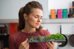 Young housewife enjoying fresh spices herbs Royalty Free Stock Photo
