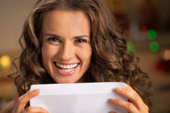 Young housewife with envelope Stock Photo