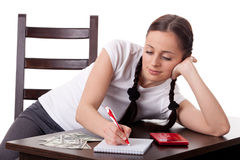 Young housewife. Family budget. Royalty Free Stock Image