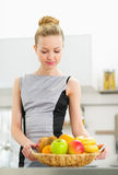 Young housewife forming plate of fruits stock photo