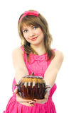 Young housewife giving us a clay pot Royalty Free Stock Photography