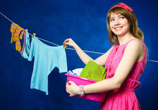 Young housewife hanging clothes on clothesline Royalty Free Stock Photography