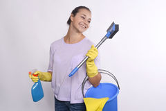 Young housewife holding cleaning products. Royalty Free Stock Photography