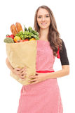 Young housewife holding a grocery bag Stock Photos
