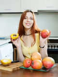 Young housewife holding ripe mango Royalty Free Stock Images